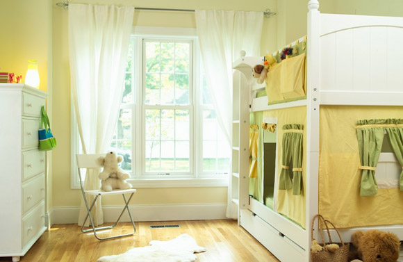 girls bunk with yellow and green curtain